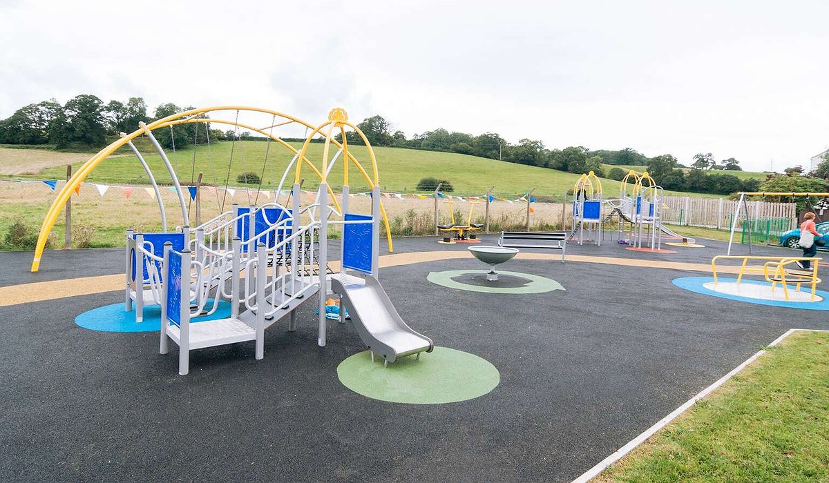 A new colourful play area with climbing frames, swings and slides in Ruthin.